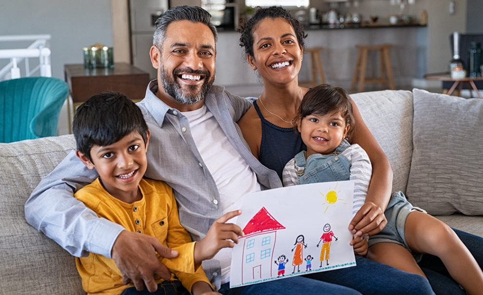 Happy family showing painting with new home